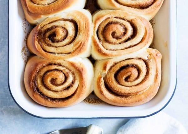 A pan of easy cinnamon rolls baked golden brown.
